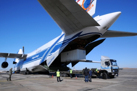 BAIKONUR, KAZAKHSTAN - NOVEMBER 11, 2013. Russian Volga-Dnepr Antonov AN-124 long-range heavy transport plane is being unloaded in Yubileiny airport.