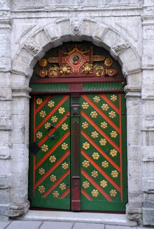 bass relief: Entrance to the Brotherhood of Blackheads building in Tallinn, Estonia, with St Maurice image above the green door