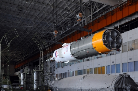 relocated: BAIKONUR, KAZAKHSTAN - DECEMBER 18, 2011: Part of Soyuz spacecraft is being relocated in Integration facility building for further assembly