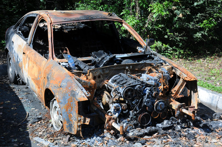 Burnt car due to arson attack at night in Russia