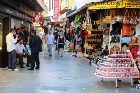 KUSADASI, TURKEY – OCTOBER 2, 2009: Tourists and local people in the market area in the town of Kusadasi