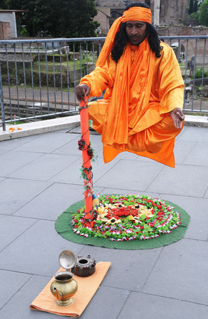 deceit: ROME, ITALY – APRIL 28, 2014: Indian Fakir performs levitation trick in Rome.