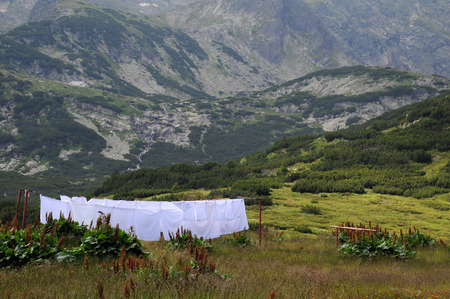 bedlinen: White bed linen on the line against the background of the Rila mountains in Bulgaria