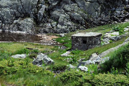 rocky mountain juniper: Abandoned barn in the Rila Mountains in Bulgaria