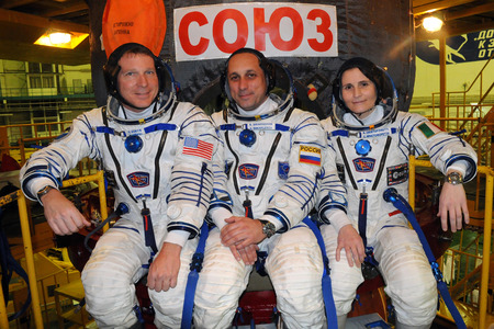 soyuz: BAIKONUR, KAZAKHSTAN - NOVEMBER 12, 2014: Expedition 42-43 ISS crew (L-R: T.Virts, A.Shkaplerov, Samantha Cristoforetti) pose for pictures in front of their Soyuz TMA-15M spacecraft. They fly to ISS on November 23, 2014 Editorial