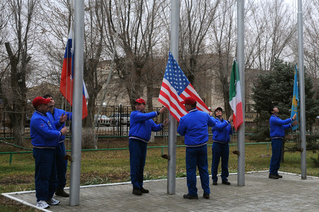 yui: BAIKONUR, KAZAKHSTAN � NOVEMBER 13, 2014:  At the Cosmonaut Hotel crew quarters Expedition 4243 prime and backup crewmembers raise the flags of Russia, the U.S., Italy and Kazakhstan in traditional ceremony