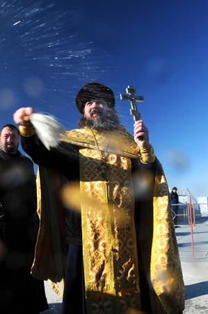 soyuz: BAIKONUR, KAZAKHSTAN � NOVEMBER 22, 2014: Group of photographers receive blessing from Orthodox priest Father Sergius following Soyuz TMA-15M spacecraft blessing Editorial