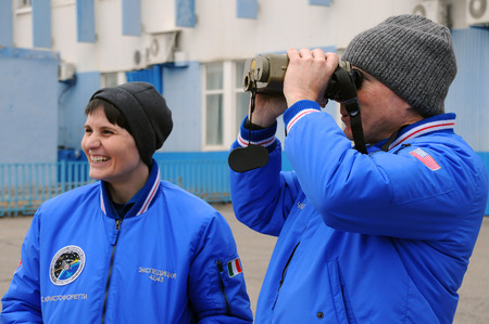 finder: BAIKONUR, KAZAKHSTAN � NOVEMBER 12, 2014: ISS Expedition 4243 crewmembers S.Cristoforetti (left) and T.Virts use laser range finder during training Editorial