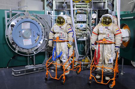 STAR CITY, RUSSIA – MARCH 18, 2015: Orlan spacesuits and airlock operations trainer in the Cosmonauts' Training Center for EVA training on ISS exterior Editorial