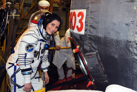 BAIKONUR, KAZAKHSTAN  NOVEMBER 12, 2014: NASA Flight engineer Samantha Cristoforetti before entering Soyuz TMA-15M spacecraft hatch for a dress rehearsal fit check in the Baikonur Cosmodrome Integration Facility.