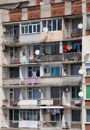 bedraggled: Facade of the shabby apartment house in Bulgaria Stock Photo