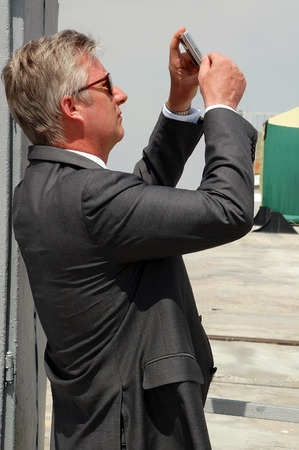 soyuz: BAIKONUR KAZAKHSTAN  MAY 27 2009: Crown prince of Belgium Philippe now King of the Belgians takes photos with Sony PS camera at the cosmodrome before Soyuz spaceship launch Editorial
