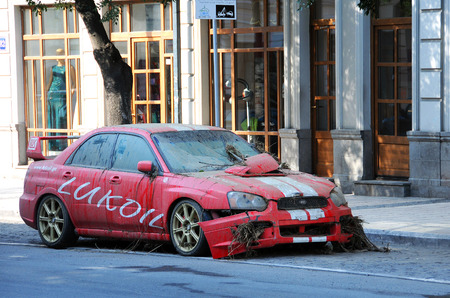 tragic: TBILISI, GEORGIA - JUNE 15, 2015: Lukoil car in the street of the city removed from the mud and sludge after it had been washed away during the tragic flood on the 14th of June, 2015 Editorial