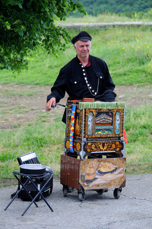 MTSKHETA, GEORGIA – JUNE 14, 2015: Barrel organ player near Jvari monastery outside Mtskheta 20 km away from Tbilisi