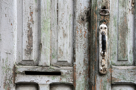 scraped: Part of aged shabby door in the capital of Georgia Tbilisi Stock Photo