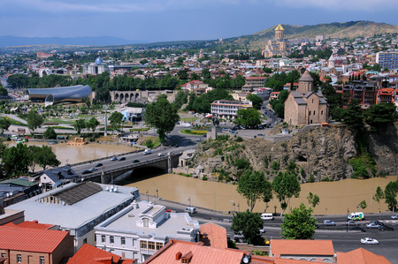 tragic: TBILISI, GEORGIA � JUNE 13, 2015: Aerial view of the concert hall, Trinity church and Metekhi church from Narikala fortress less than 12 hours before the tragic flood on June 14