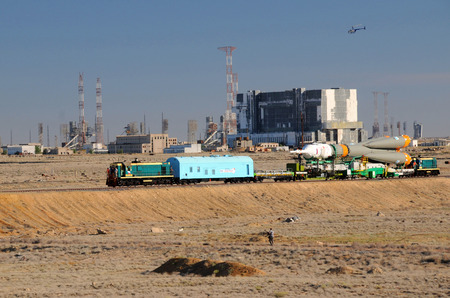 soyuz: BAIKONUR, KAZAKHSTAN � JUNE 13, 2010: Soyuz rocket is being rolled out to the launch pad along the railroad tracks at Baikonur cosmodrome Editorial