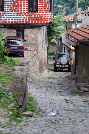 tarnovo: VELIKO TARNOVO, BULGARIA - JULY 16, 2014: Cars in narrow medieval street downtown