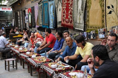 tea house: IZMIR, TURKEY - OCTOBER 3, 2009: Guests in the tea house in the center of the city drink tea and coffee