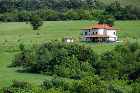 balkans: Rural landscape and lone white house in the Balkans