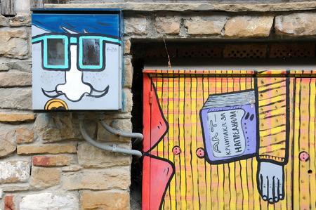 graffito: VELIKO TARNOVO, BULGARIA - JUNE 26, 2016: Creative graffiti in the Old Town