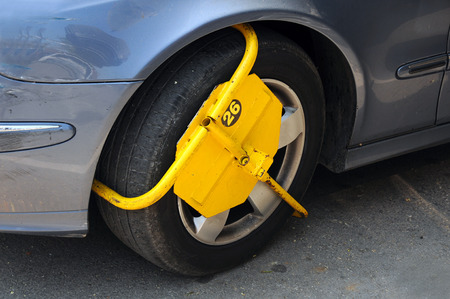 parking violation: Wheel lock attached for illegal parking in Bulgaria Stock Photo