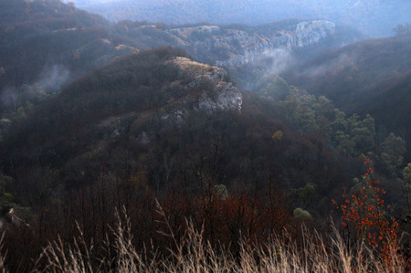 Hazy dawn in the Balkan mountains in the fall