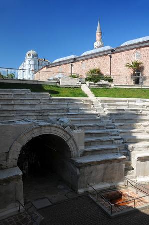 PLOVDIV, BULGARIA - MAY 3, 2019: View of ancient stadium and Dzhumaya Mosque