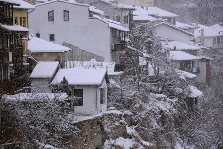 VELIKO TARNOVO, BULGARIA – JANUARY 07, 2019: View of the houses and trees on the hill in the winter Editorial