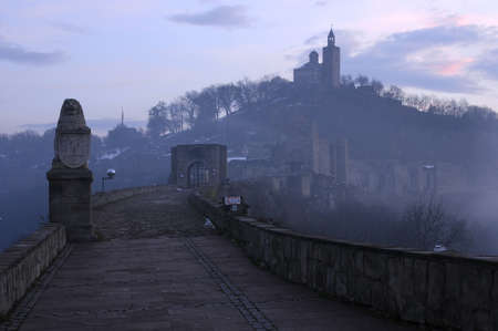 Fuzzy view of medieval Tsarevets stronghold in the city of Veliko Tarnovo in Bulgaria on foggy morning