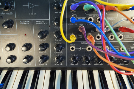 jacks: vintage analog synthesizer with patch panel and cords