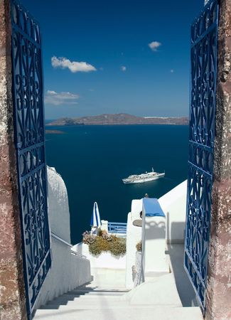 Open gates invites you to explore Santorini island Stock Photo