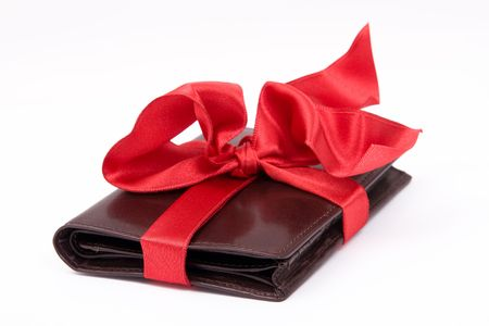 closed ribbon: Leather brown wallet gift with big red bow Stock Photo