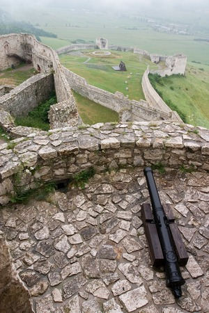 Fortification with cannon gun in medieval Spissky Hrad castle Stock Photo