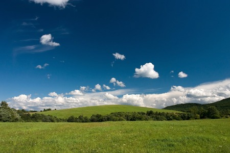 Summer  landscape with cumulus and green meadows Stock Photo - 1414820