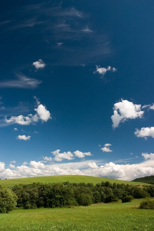 Summer  landscape with cumulus and green meadows Stock Photo - 1414816