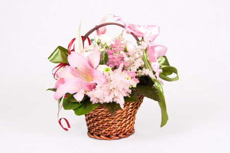 Basket full of variety flowers and green bow