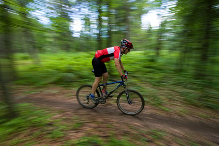 Mountain Biker during mtb competition with blurred background Stock Photo