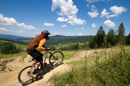 Female mtb biker during downhill event