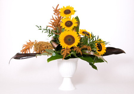 Summer decoration with sunflowers and green leafs Stock Photo - 1456330