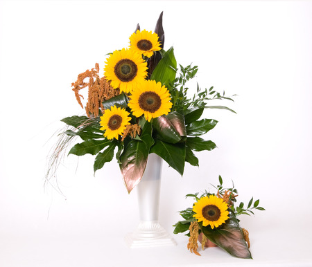 Summer decoration with sunflowers and green leafs Standard-Bild