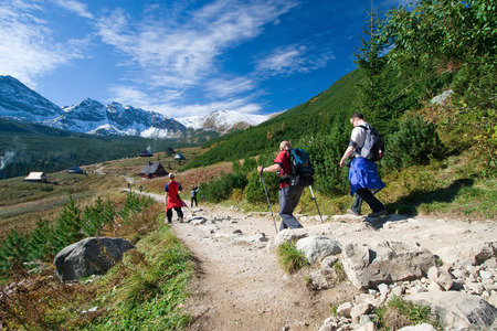 Group of people trekking in Tatra Mountains, Poland Stock Photo