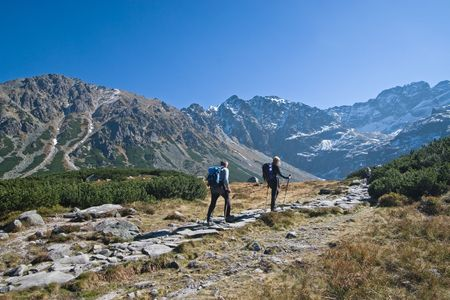 Couple trekking in Tatra Mountains during late autumn, Poland Stock Photo