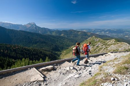 Couple is trekking in mountains. Tatra Mountains, Poland