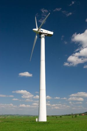 One wind turbine against blue sky with white clouds Stock Photo - 3010586