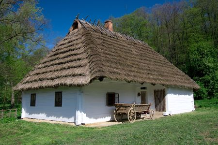 thatched roof: Very old Polish white hut with thatched roof Stock Photo