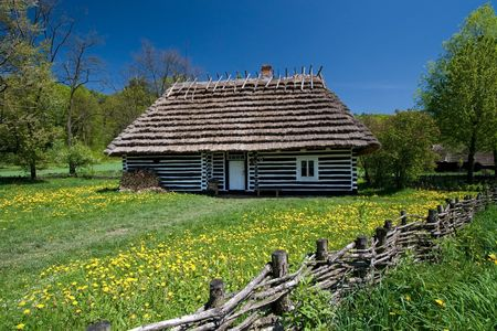 Very old house from Poland with thatched roof. Beautiful spring day.