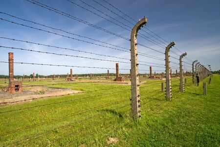 Barbed wire fence in Auschitz Birkenau Museum in Oswiecim, Poland photo