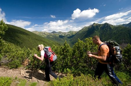 Couple is trekking in Tatra Mountains, Slovakia