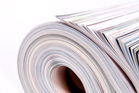 Three color magazines rolled on white background